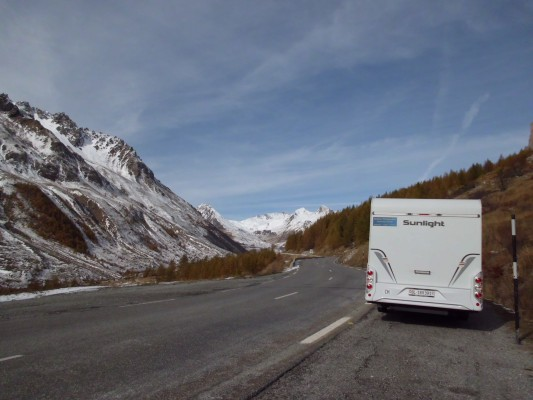 Mountain road and first snow in France, holiday with camper van